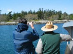 Darcy and Pete look at the shore of Rocky Point where over 400 burial cairns,which they have documented are located.