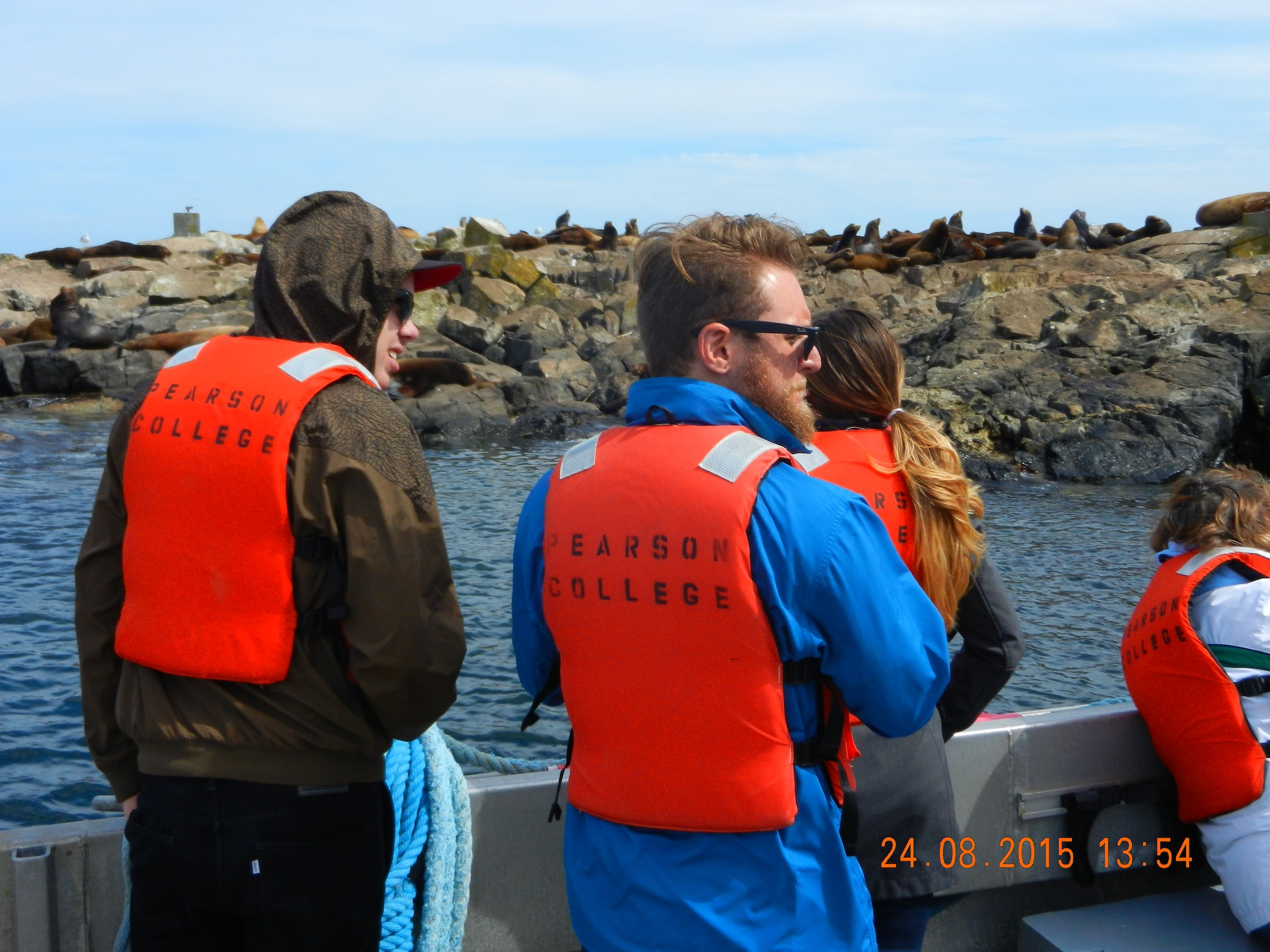 Sean Lundy and friend Rob Bellevia view the sea lions at the jetty.