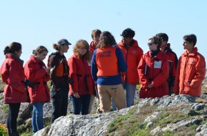 Laura and students reflecting on Race Rocks.