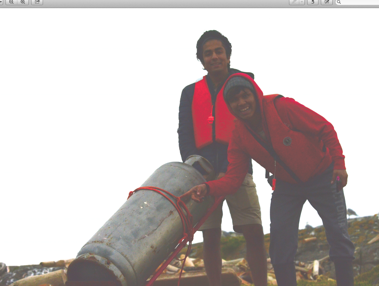 Keneshka and Kyle (note the nice knots) moving a propane cylinder.